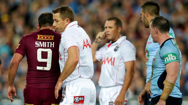 Referees Ben Cummins and Shayne Hayne had to manage a niggly Origin II.