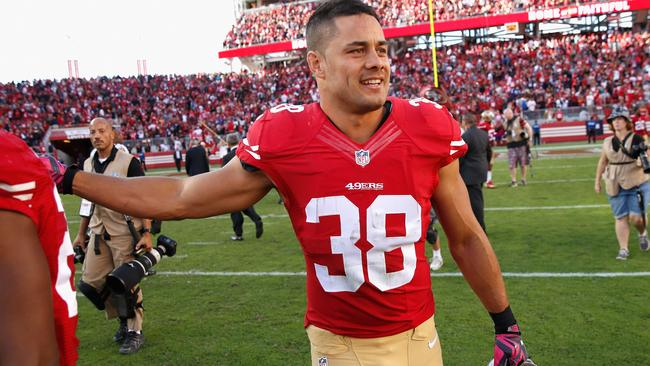 Jarryd Hayne walks off the field after the 49ers beat the Baltimore Ravens.