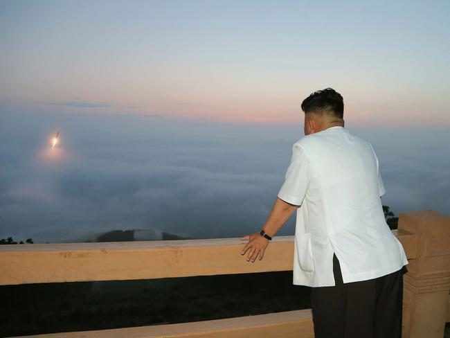 Watching on ... this undated picture released from North Korea's official Korean Central News Agency shows Kim Jong-un inspecting a tactical rocket firing drill.