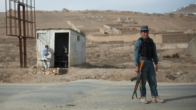 An Afghan policeman mans a checkpoint on the outskirts of Maidan Shahr, Wardak province, Afghanistan. Picture: AP