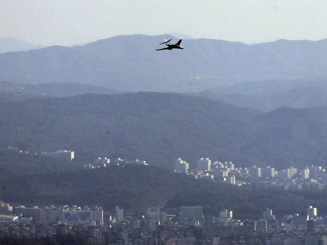A US Air Force B-1B bomber flies near the Seoul Airport near a site for the 2017 Seoul International Aerospace and Defence Exhibition. Picture: Yonhap via AP