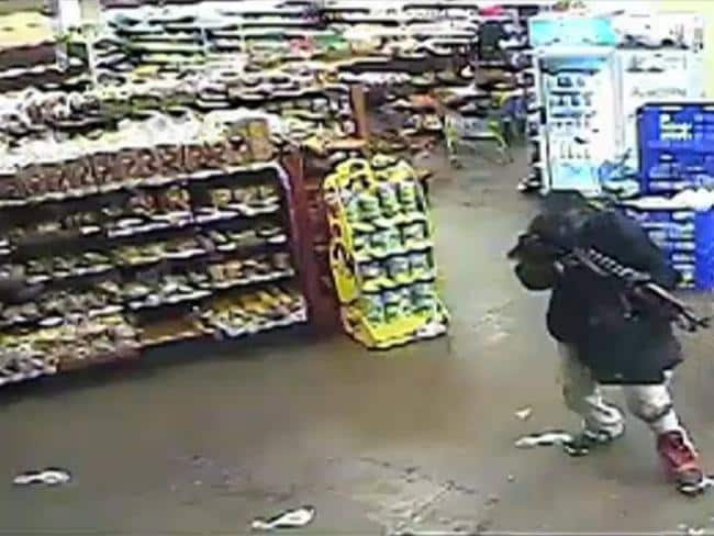 On the hunt ... A CCTV capture from September 21, 2013, shows an armed man seeking victims in Westgate Mall, Nairobi. Source: Supplied