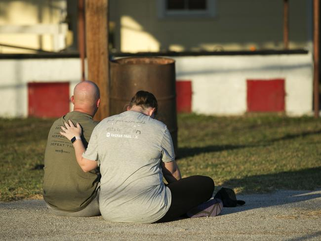 A couple comfort each other at a community centre in Sutherland Springs, Texas. Picture: AP