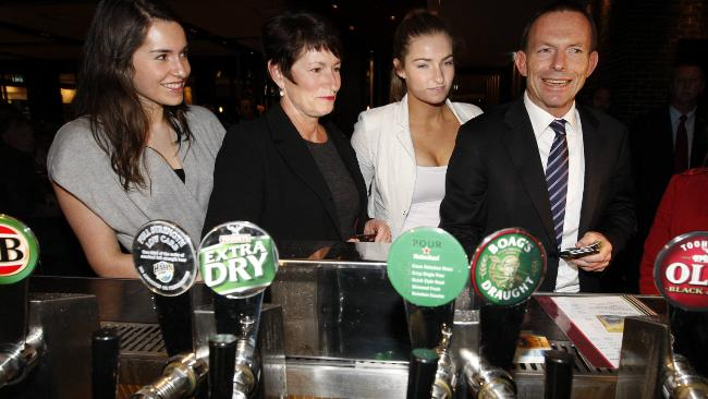 Tony even likes to shout the family a drink, pictured here with wife Margie and two of his three daughters. Picture: Ray Strange