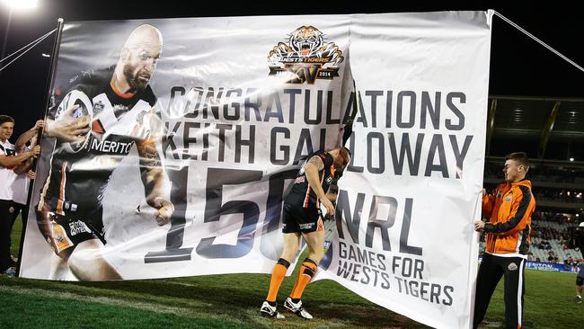 Tigers Keith Galloway celebrates his 150th NRL game.
