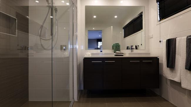 The main bedroom, at the rear of the upstairs level, has an ensuite with a double basin. Picture: John Fotiadis