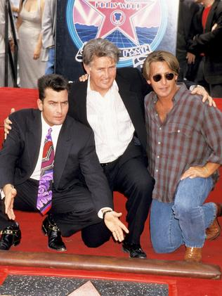 Family ... Charlie Sheen, with dad Martin Sheen and brother Emilio Estevez, at the unveiling on his star on the Hollywood Walk of Fame in 1994. Picture: Getty