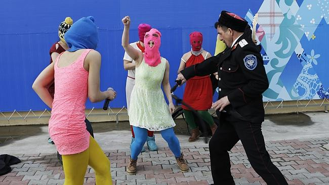 Whipped ... Members of the punk group Pussy Riot, including Nadezhda Tolokonnikova in the blue balaclava and Maria Alekhina in the pink balaclava, are attacked by Cossack militia in Sochi, Russia