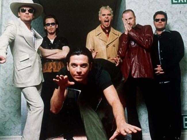 INXS in 1997 from left, Tim Farriss, Kirk Pengilly, Michael Hutchence, foreground, Jon Farriss, Garry Gary Beers and Andrew Farriss. Picture: Supplied