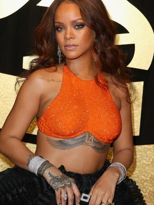 Rihanna got the Goddess Isis tattoo in memory of her grandmother. Picture: Joe Scarnici/Getty Images for FIJI Water