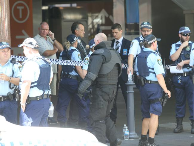 Police gather at Circular Quay, while bystanders are evacuated.