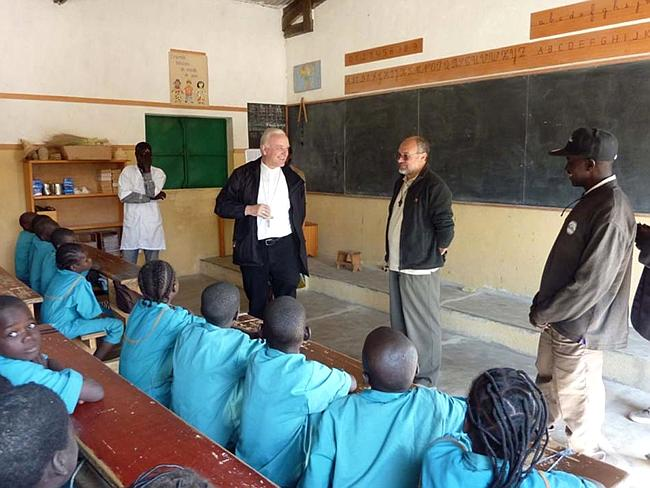 Esteemed ... Vicenza Bishop Beniamino Pizziol, second from left, with father Gianantonio Allegri, second from right, during a visit in the Catholic primary school of Tchere, Cameroon, in January. Picture: Vicenza Diocese