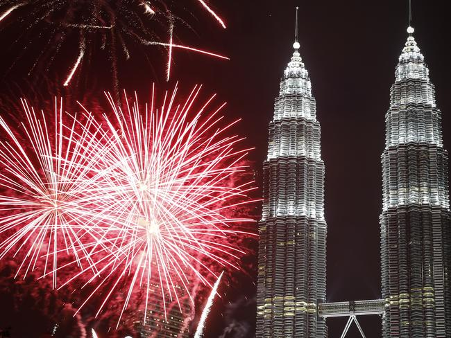 Fireworks explode in front of Malaysia's Petronas Twin Towers.