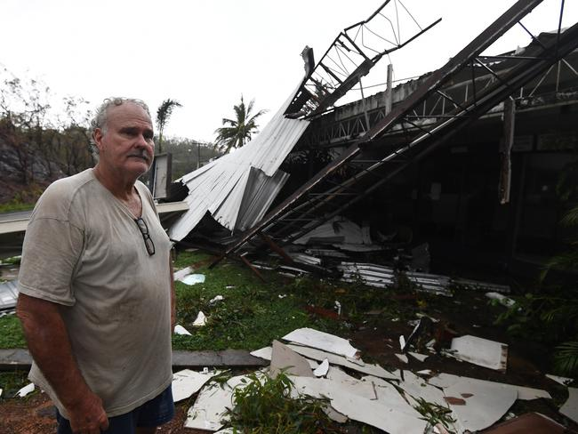 Dave Mcinnerney inspects the damage to his motel at Shute Harbour, Airlie Beach. Picture: Dan Peled/AAP