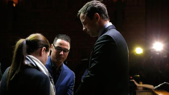 Supporting his brother ... South African athlete Oscar Pistorius prays with his brother Carl Pistorius and his sister Aimee Pistorius prior to his indictment hearing in Pretoria Magistrates Court. Picture: Jemal Countess/Getty Images