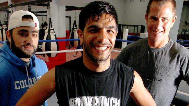 Trainer Billy Hussein, Australian boxer Billy Dib and trainer Shannon Ponton.