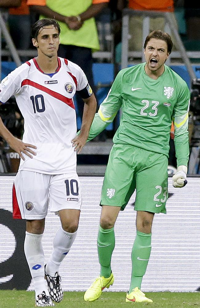 Netherlands' goalkeeper Tim Krul, right, celebrates after saving a penalty from Costa Rica's Bryan Ruiz.