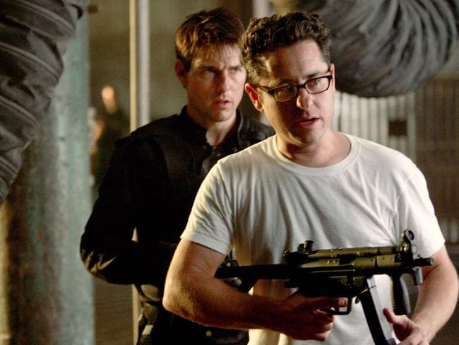 Mates ... Actor Tom Cruise (back) with director JJ Abrams on the set of 2006 film Mission Impossible III'.