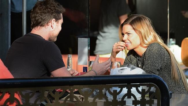 Sophie Monk and Sam Worthington in South Yarra in April.