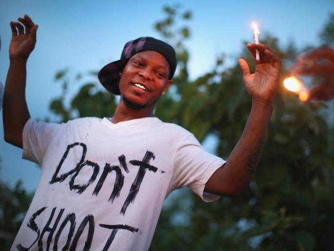 Don't shoot ... a demonstrator makes his point over the shooting death of Michael Brown. Picture: Scott Olson/Getty Images/AFP