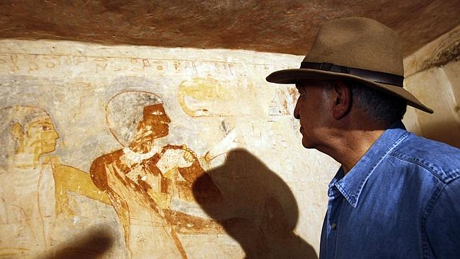 Zahi Hawass, former head of Egypt's Supreme Council of Antiquities, tours a recently discovered tomb of a priest near the Giza Pyramids.