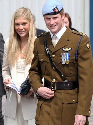 Prince Harry of Wales walks with his girlfriend Chelsy Davy after receiving his Helicopter Pilot's wings in 2010.