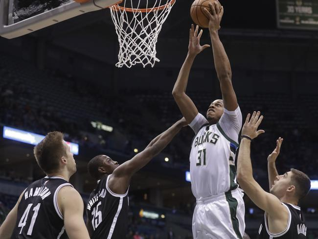 Milwaukee's John Henson gets up and through the traffic.