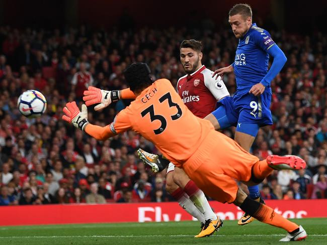 Jamie Vardy of Leicester City scores his team's second goal past goalkeeper Petr Cech.