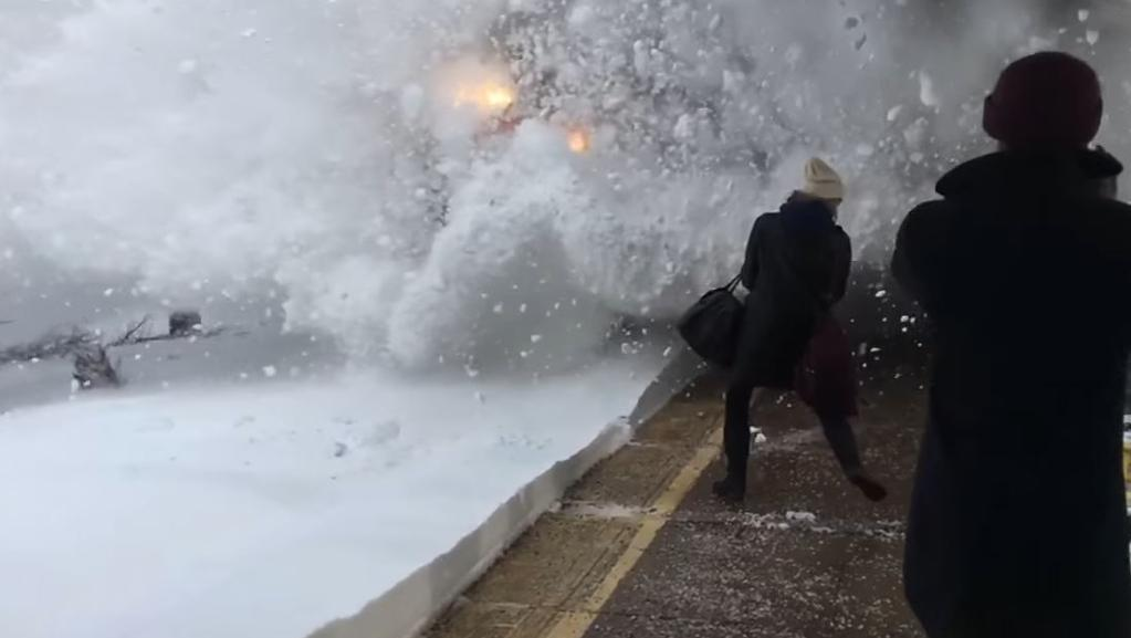 Commuters were engulfed in snow as the train pulled into the station in New York. Picture: YouTube/Nick Colvin