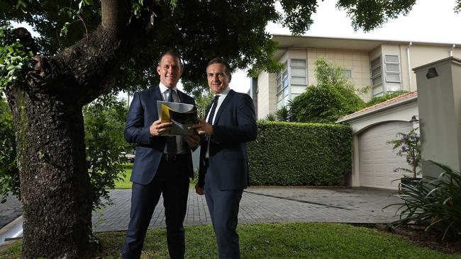 Ray White New Farm principal Matt Lancashire (L), with Hamish Bowman, negotiated four of the top five house sales in 2017, including the house behind them at 24 Palm Ave, Ascot. Picture: Lyndon Mechielsen.Source:News Corp Australia