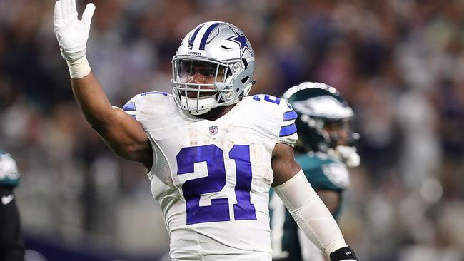 Ezekiel Elliott #21 of the Dallas Cowboys celebrates after a first down.