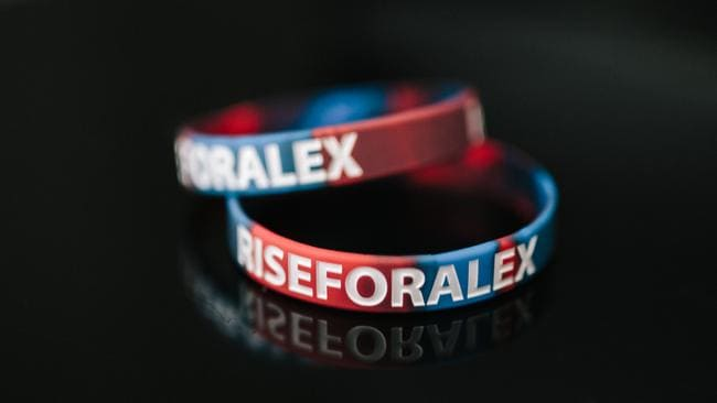'Rise for Alex' armbands will help support McKinnon as he recovers from a spinal injury.