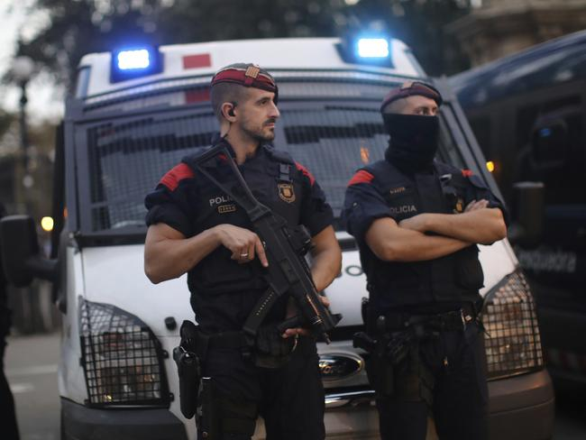 Spanish police officers stand guard at the entrance to the Parliament of Catalonia in Barcelona. Picture: AP Photo/Emilio Morenatti
