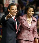 <p>Democratic presidential candidate US Senator Barack Obama and his wife Michelle arrive on stage at his South Carolina primary night rally in Columbia, South Carolina.</p>