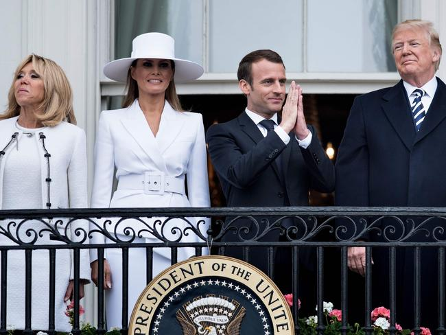 The Macrons and the Trumps stand on the Truman Balcony during a state welcome ceremony on the South Lawn of the White House. Picture: AFP/Brendan Smialowski