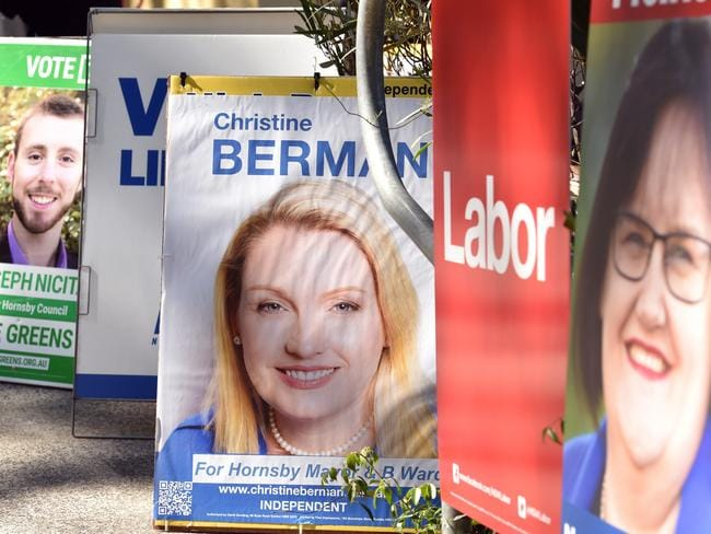 Candidate posters greeted voters as they make their way to the polling booth at Hornsby Girls High School. Pic: AAP/Troy Snook