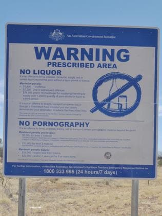 Signs — like this one outside Alice Springs — were erected in many Aboriginal communities following the rollout of the NT Intervention.