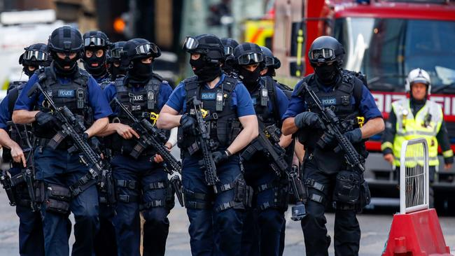 London ... Armed police officers patrol streets after the June attack
