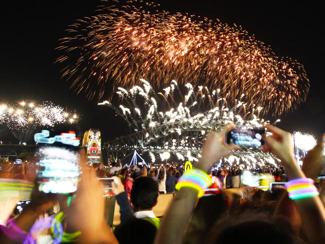 Main event ... revellers in Sydney captured every moment on their camera phones. Picture: Hollie Adams/The Australian