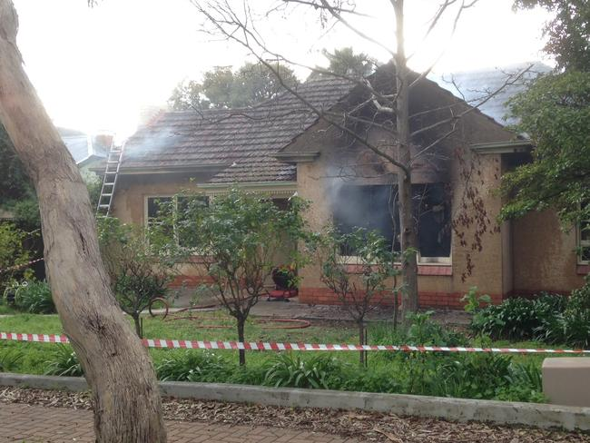 Some rises out of the windows at the house fire at Linden Park. Picture: Sam Wundke