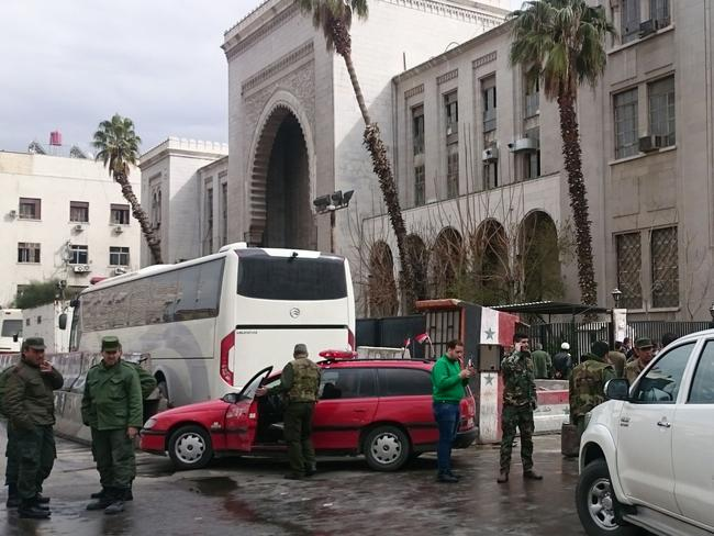 Syrian security forces cordon off the area following a suicide bombing at the old palace of justice building in Damascus. Picture: AFP