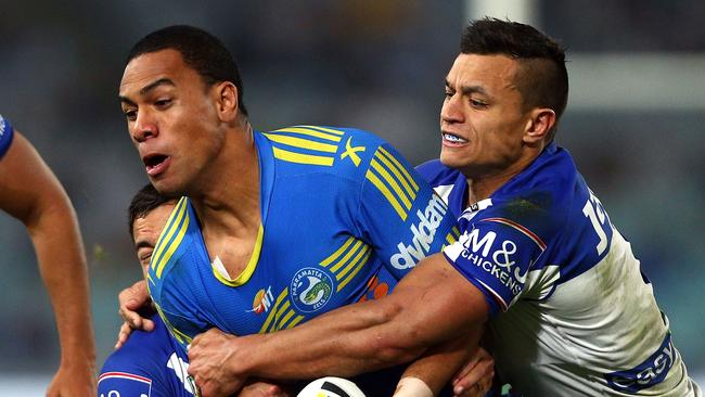 Will Hopoate of the Eels is tackled by Sam Perrett of the Bulldogs during the round 23 NRL match.