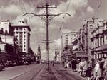 The elegant tram powerlines of King William St in 1956.