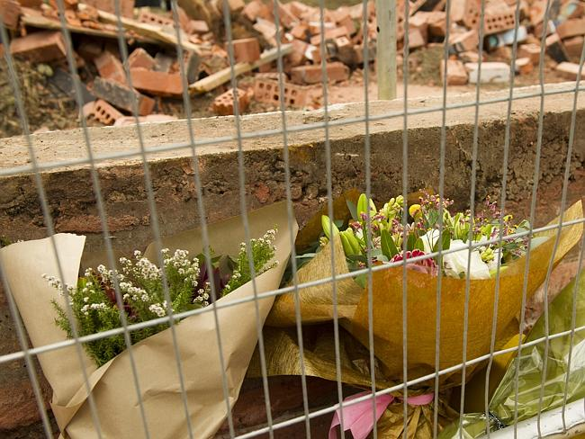 People left floral memorials to the victims of the Grocon wall collapse in 2013.