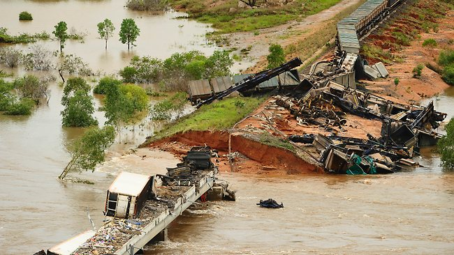 The freight train that derailed at the Edith River Crossing after flood waters washed away the tracks. Picture: Michael Franchi