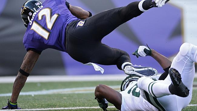 Wide receiver Jacoby Jones #12 of the Baltimore Ravens scores a touchdown against the New York Jets in the third quarter.