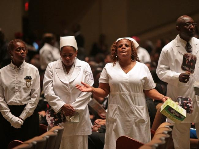 People gather inside Friendly Temple Missionary Baptist Church for the funeral for Michael Brown. Source: AP