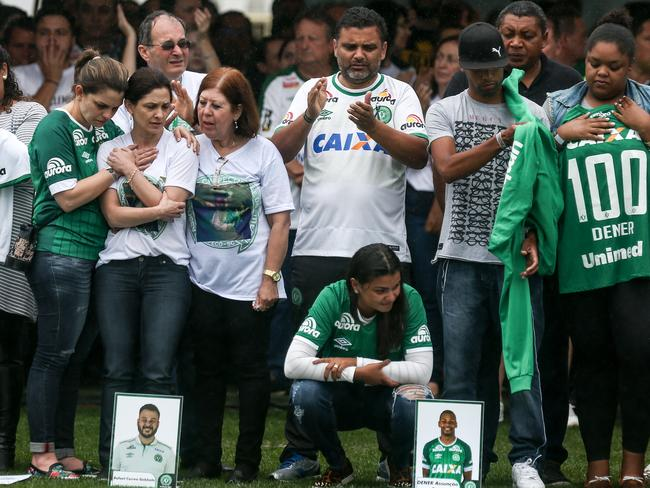 Relatives of the members of Brazilian team Chapecoense Real pay a tribute at the club's Arena Conda stadium in Chapec. Picture: Buda Mendes/Getty Images