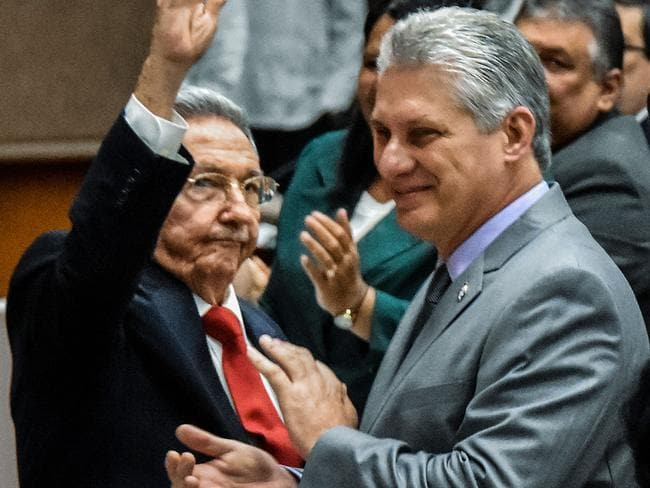 Cuban President Raul Castro (L) waves goodbye next to First vice-president Miguel Diaz-Canel. Picture: AFP