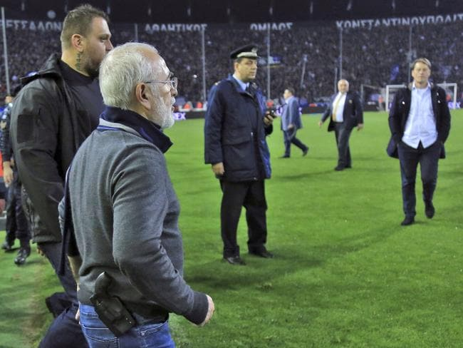 PAOK owner, businessman Ivan Savvidis invades into the pitch during the Greek League soccer match between PAOK and AEK Athens